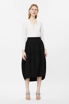 COS - This rounded cocoon skirt is made from a lightweight wool with a silky lining. Designed to sit on the waist, it has two in-seam pockets, hidden back zip fastening and a slightly graduated hemline Cos Skirts, Short Skirts, Dress Skirt, Midi Skirt, Cocoon Dress, Structured Dress, Mid Length Skirts, High Waisted Skirt, Style Inspiration