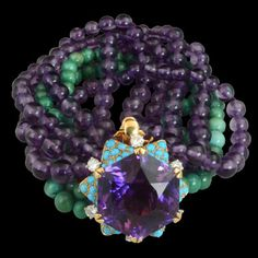 Amethyst, tourquoise & diamond bracelet designed as five rows of amethyst and two rows of turquoise beads, to a star-shaped clasp, set at the centre with an hexagonal amethyst within a turquoise and diamond border, accented with circular-cut diamonds by Cartier, Paris 1954, for the Duchess of Windsor. Hancocks.