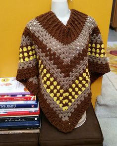 Hot Off My Hook! Project: Cowl Neck Poncho Started: 21 Aug 2016 Completed: 25 Aug 2016 Model: Madge the Mannequin Crochet Hook(s): 7.0mm Cowl Portion, K, Granny Stitch portion Yarn: Redheart Super Saver, Bernat Super Saver, I Love This Yarn Color(s) Walnut, Honey,Yellow Pattern Source: Simply Crochet Magazine, Issue No. 25 (Hard Copy) Pattern Designed By: Simone Francis Notes: This is my 88th Cowl-Neck Poncho! My Mother picked the colors!