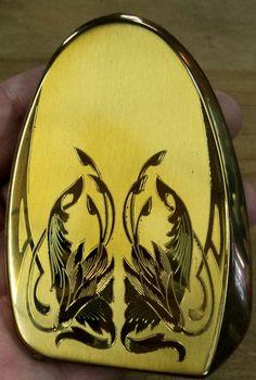 Goldtone compact