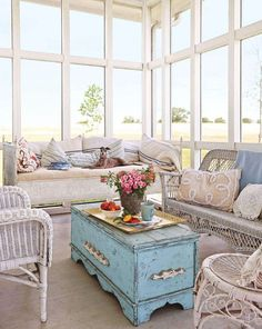 Sunroom windows - Employ an old trunk as a coffee table, and you'll get two for the price of one. Not only is it a coffee table, it's the perfect storage spot for stashing blankets, games, and living room extras. Sunroom Furniture, Wicker Furniture, Shabby Chic Furniture, Vintage Furniture, Furniture Ideas, Furniture Stores, Modern Furniture, European Furniture, Furniture Refinishing