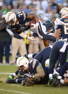Ryan Mathews #24 of the San Diego Chargers jumps over the front line for a first down against the Seattle Seahawks at Qualcomm Stadium on 8 Aug 2013
