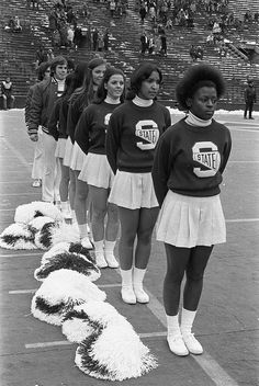Cheerleaders at the MSU vs Northwestern football game, 1972 by Michigan State University Archives, via Flickr