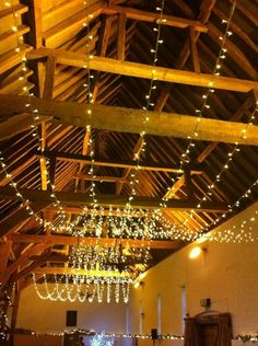 Festoon of lights from Oakwood Events adds a magic sparkle to proceedingd for a December wedding at Ufton Court.