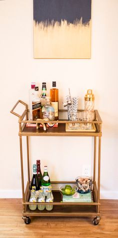 Okay so I like this bar cart but I also love the wall art above it…that would be so easy to make! www.lovecheria.com