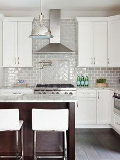Subway Tile Backsplash With Herringbone Pattern Behind Stove Top - Subway-tile-backsplash-design
