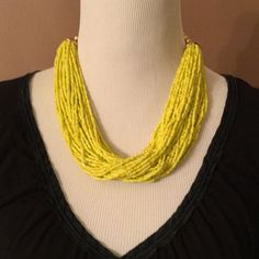 FINAL PRICE!!  Beaded Yellow Necklace  NWOT Pretty yellow small beaded necklace.  gold tone beaded chain. Total length 20 inches unhooked. Shown with black peasant blouse, but would look great dress up or down. I count 40 strands of yellow bead strings, but surprisingly not heavy.   m. haskell Jewelry Necklaces