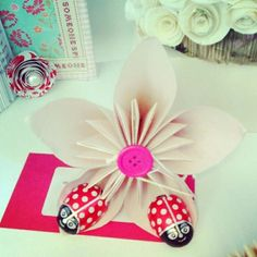 Paper flower with two small ladybird chocs.