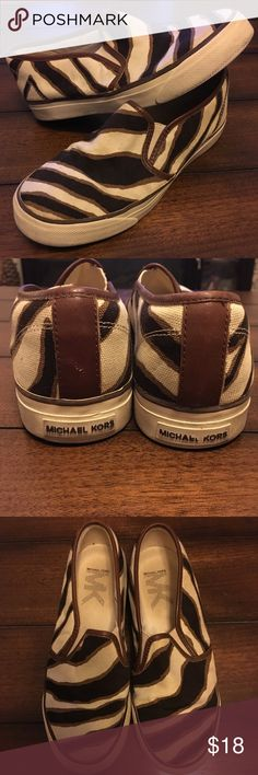 Michael Kors slip on shoes Size 6 1/2 black, gold, and cream zebra pattern. The cream rubber soles do show some wear and the back emblem is slightly faded (pictured) Super cute and comfortable! Michael Kors Shoes Flats & Loafers