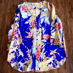 YUMI KIM Blouse Floral Printed Lizzie Button Top Size Small. New without tags. $168 Retail + Tax.   Stunning silk printed blouse with button front detailing and blue Hawaiian print. 3/4 Length tabbed sleeves. Loose, chic and airy.   100% Silk. Imported.      ❗️ Please - no trades, PP, holds, or Modeling.    Bundle 2+ items for a 20% discount!    Stop by my closet for even more items from this brand!  ✔️ Items are priced to sell, however reasonable offers will be considered when submitted…