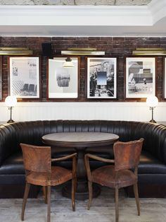 Rustic leather chairs, marble tabletop and exposed brick walls is the perfect combination for a bar. Kudos to Soho House Toronto.