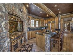 Oh my!!  Love the entire kitchen. Especially the rock around the stove.