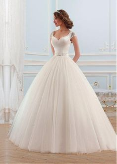 Alluring Tulle V-neck Neckline Ball Gown Wedding Dress With Beadings And Rhinestones