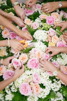 Floral DIYs in progress | Photography: Kevin Chin Photography + Cinema - kevinchin.com Read More: http://www.stylemepretty.com/california-weddings/2015/05/06/hawaiian-garden-party-wedding-inspiration/