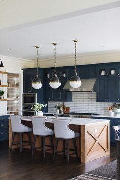 kitchen lighting pendants. Three Small Hicks Pendants Hang Over An Gold Wood Center Island Seating  Light Blue Upholstered Counter Kitchen Lighting Pendants