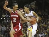 GALLERY: Minnesota's Kiara Buford tried to make to to the basket while being defended by Wisconsin'sTaylor Wurtz during the first half at Williams Arena in Minneapolis on Thursday, Jan. 26, 2012. http://www.startribune.com/sports/gophers/138171219.html