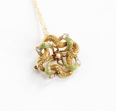 Gorgeous antique 14k yellow gold love knot pendant necklace. This ornate Edwardian Era piece features an intertwined knot design, which can