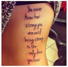 Very interesting and motivated tattoo inked on the side ribs