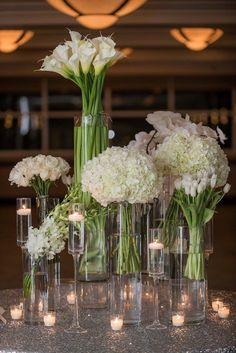 The same three flowers on either side of the altar and a big puff st the end Calla Lily Wedding Arrangements, Hotel Flower Arrangements, Calla Lily Centerpieces, Tall Floral Arrangements, Modern Wedding Centerpieces, Silver Wedding Decorations, Flower Decorations, Hotel Flowers, Calla Lilies