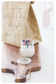 homemade müsli with oatmeal, milk, yogurt, agave nectar, grated apple, toasted almonds, cinnamon and fresh berries