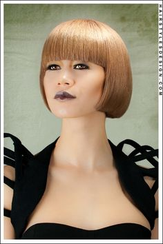 Hair Style: Here we have a straight, bob style look that is easy to care for and maintain. This is a chic look as the hair is straight all around. This classy do has a great fringe on the forehead that is full and styled right across.  Hair Cut: This haircut is short.  Hair Colour: The hair colouring is a golden brown.