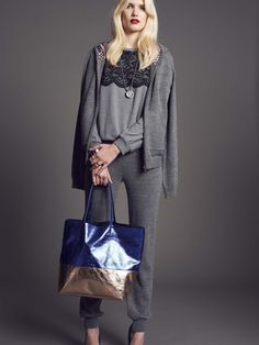 Model wears Naughty Dog tricot #cardigan and jogging #trousers; fleece blouse with lace top, decorated with Swarovski elements; metallic eco leather shopping bag.