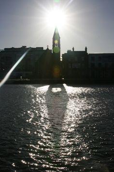 sun sets over church bells