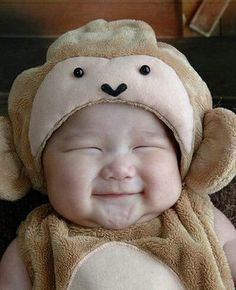 "CUTE! baby in a monkey costume -  I'm loving the ""brain squeeze"" smile (where you have to smile so badly that you squeeze the eyes shut - usually accompanies by clenched jaw)"