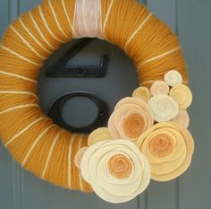 Yarn Wreath Felt Handmade Door Decoration - Peach Cobbler 8in. $35.00, via Etsy.