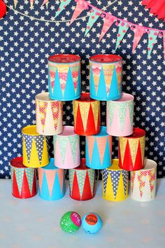 Activity : Attach colorful scrapbook paper to painted tin cans for a cute update to this classic carnival game!