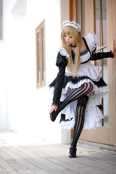 He is a Brolita...a boy who dresses like a girl Lolita. I like his tights. B