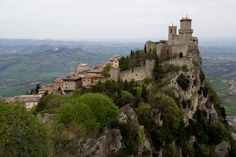 Guaita is one of three peaks which overlooks the city of San Marino, the capital of San Marino. The other two are De La Fratta and Montale. The Guaita fortress is the oldest of the three towers constructed on Monte Titano, and the most famous. It was built in the 11th century and served briefly as a prison. It is one of the three towers depicted on both the national flag and coat of arms.    Photo credit - Marco Franchino