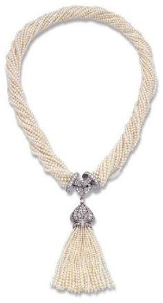 AN ART DECO SEED PEARL AND DIAMOND SAUTOIR, MOUNTED BY CARTIER. The 18 rows of seed pearls to the diamond-set clasp and detachable diamond and seed pearl tassel, circa 1920. Clasp signed MTG Cartier, numbered. #Cartier #ArtDeco #sautoir #necklace