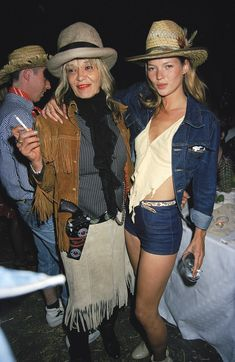 From those iconic 90's outfits to her modern day rock'n'roll bohemian style, we look back at 20 of Kate Moss's top looks.