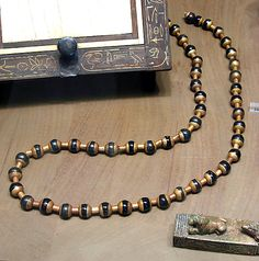 Necklace of Renisenib, Middle Kingdom, Dynasty 12-13, Egypt, circa 1810-1700 BC, gold and obsidian