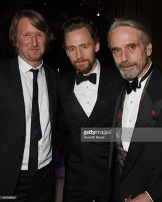 insanely-smart:  LONDON  ENGLAND - OCTOBER 03: (L to R) Tom Hooper Tom Hiddleston and Jeremy...