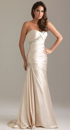 Strapless fit and flare gown with rich, sparkling crystal details. The sweetheart neckline is completed with ruching with beaded detail at the hip.