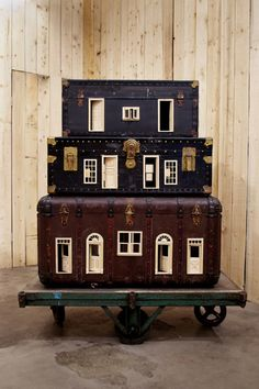 Bo Christian Larsson Mobile Home, 2012 Vintage suitcases, dollhouse doors and windows, and industrial wagon