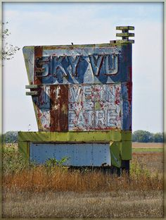 The entrance sign for the long abandoned Sky Vu Drive-In Theater on old US 40 in Russell, Kansas.