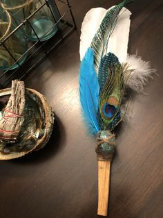 Create a positive space using a Sacred Spirit wand. Fun Diy Crafts, Summer Crafts, Creative Crafts, Crafts To Make, Feather Crafts, Feather Art, Peacock Feathers, Feather Bouquet, Peace Pipe