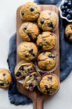 Wholesome and buttery blueberry oatmeal muffins made with honey and oats! Recipe on sallysbakingaddiction.com