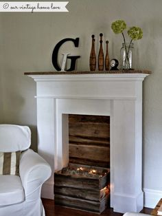 Create a subtle glow with old Christmas lights and a few fake logs. #fireplaces #decor