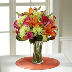 t's time to celebrate! New job, new home, a birthday, a new love? send The FTD® Starshine™ Bouquet from www.AmericasFloristnyc.com