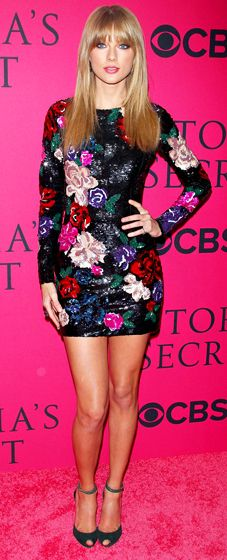 Taylor Swift in a multicolored, sparkly, sleeved mini.