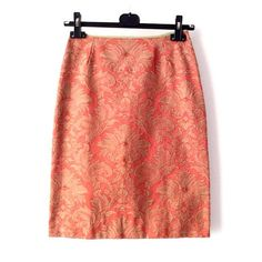 A casual orange pencil skirt created and handmade by me with this beatiful Italian Florentine damask fabric with delicate gold pattern. This high waisted skirt zips in the back, falls just above the knee, flatters your figure and defines your waist line perfectly. It is perfect for any season. This fall pair it with a tshirt, moccasins with socks and a gray coat for a casual modern look. It is Ready to Ship worldwide. Label: Pitti Vintage Handmade in Italy Size: 38 Italia-Small Material…