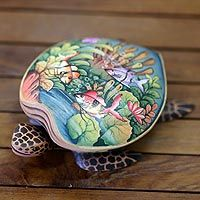 Carved from crocodile wood, this jewelry box takes the shape of a sea turtle. Gusti Ngurah Semarajaya finds inspiration in the warm Balinese sea. Beautifully painted by hand, the petit jewelry box is lined in velvet.