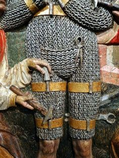 Mail armour depicted in a late medieval sculpture.