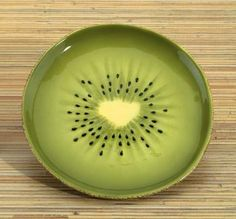 Kiwi Dessert Plate brings to your table a wonderful series of housewares inspired by nature. This Kiwi Dessert Plate looks as it was freshly picked from your garden. This plate depicts a slicked kiwi fruit. Pottery Plates, Ceramic Plates, Porcelain Ceramics, Ceramic Pottery, Pottery Art, Painted Ceramics, Painted Pottery, Pottery Painting Designs, Pottery Designs