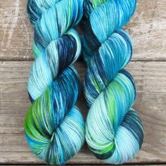 Deep ocean blue fades into sky, while green mountains stretch into bright clouds.This colorway is...