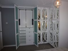 Internal detail of fitted wardrobes with shelves, drawers and pulldown hanging rail